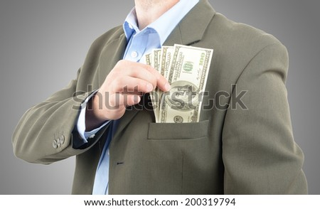 top pocket of suit stuffed with money - stock photo