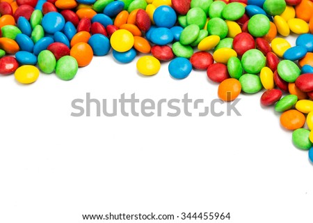 Top right frame of colorful chocolate coated candy on white background with space for text - stock photo
