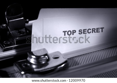 Top secret document in a folder inside an armored suitcase - stock photo
