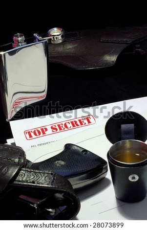 top secret documents, guns, aperetif from flack - spy celebrating a victory - stock photo