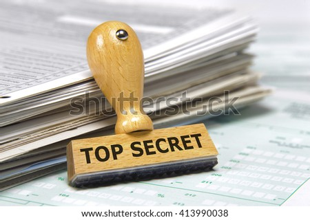 top secret documents with rubber stamp - stock photo