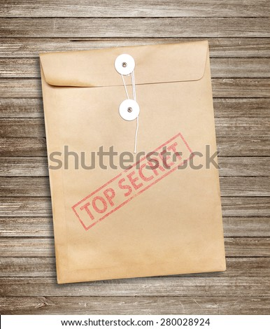Top Secret package on wood background - stock photo