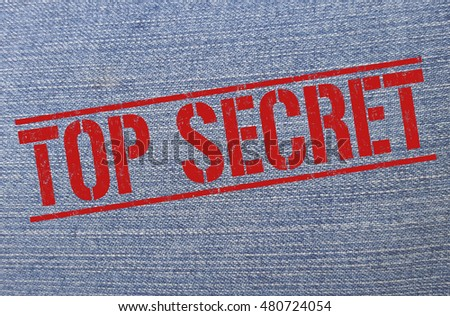 Top secret red grunge stamp on on vintage jeans texture