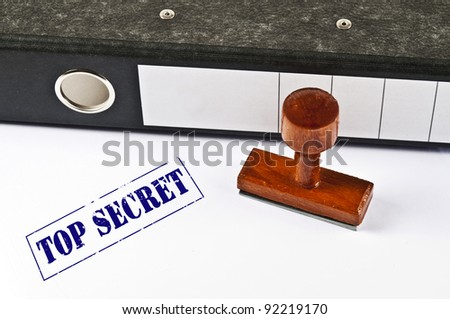 Top Secret stamp on white paper - stock photo