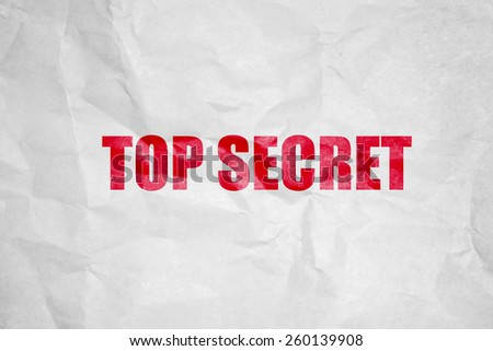 Top secret stamping on white corrugate Paper - stock photo