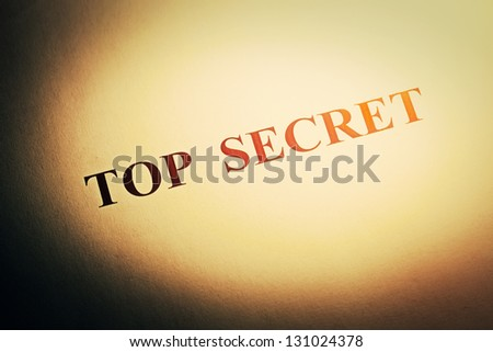 Top secret text on folder in hard light. Selective focus. - stock photo