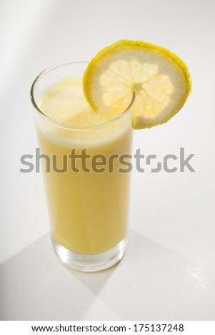 Top shot of orange juice in a glass isolated on white background