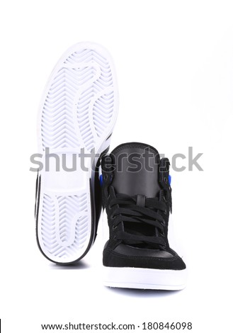 Top side and sole of fashion sneakers. Isolated on a white background. - stock photo