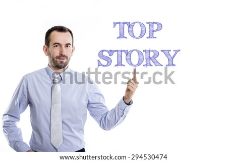 Top Story  Young businessman with small beard pointing up in blue shirt