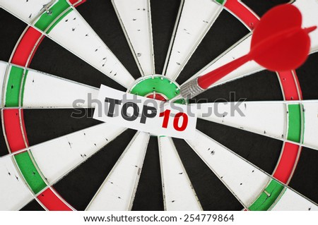 Top ten concept and a dart in center of target - stock photo