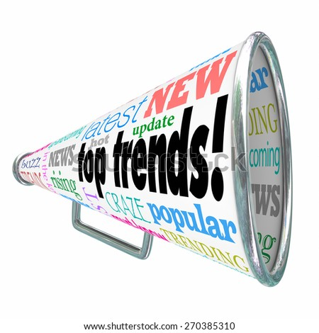 Top Trends words on a bullhorn or megaphone, with rising, news, buzz, latest, hot update, popular, craze, fad and related words - stock photo