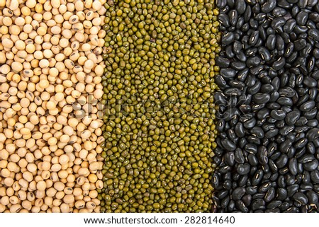 Top view background of different varieties of beans: soybeans, mung beans, black beans - stock photo