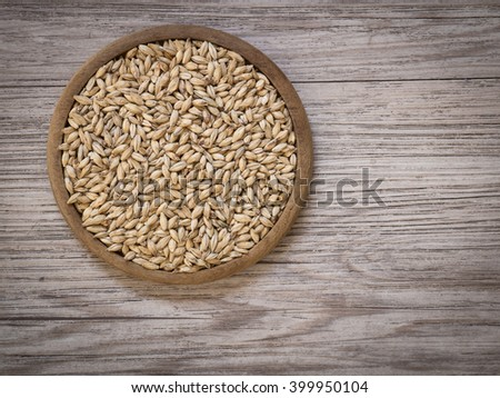 Top view - Beer ingredients, Pale ale malt on wooden background ( Space and composition for text ) - stock photo