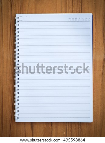 Top view blank notebook on wood background.