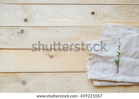 top view blooming branch spirea on wooden background