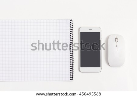 Top view business object, grid book, mobile and mouse. - stock photo