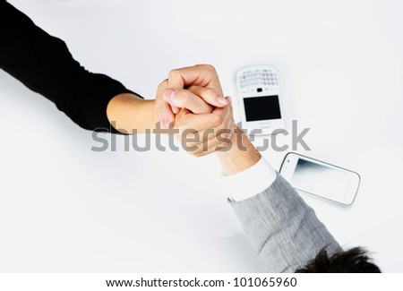 Top view  - businessman and businesswoman arm wrestling on table.