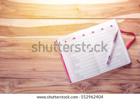 Top view 2017 Calendar with notebook on wooden desk