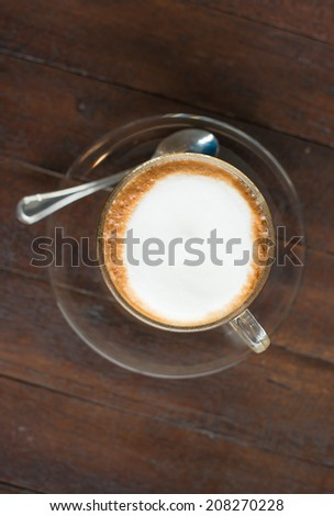 Top view Cappuccino or latte coffee  in a clear glass mug - stock photo