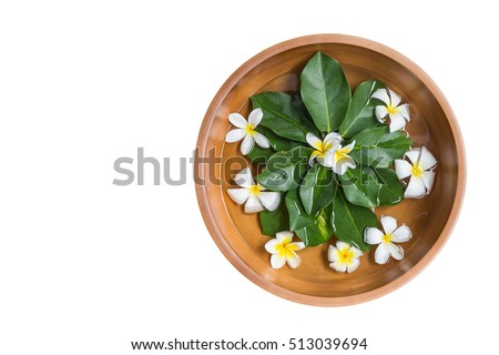 Top view clay water bowl with white flower (plumeria or frangipani) and green leaf isolated on white background. Saved with clipping path