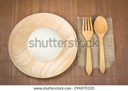 top view,close up of rice in wooden dish on wood  table. - stock photo
