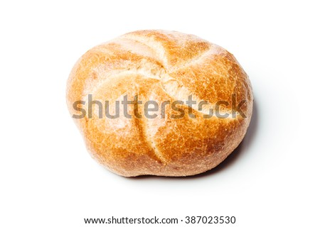 Top view closeup on bread roll on reflecting surface, isolated on white background.