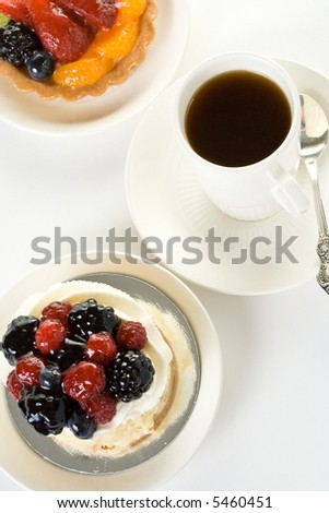 Top view coffee cup with fruit cakes  on white