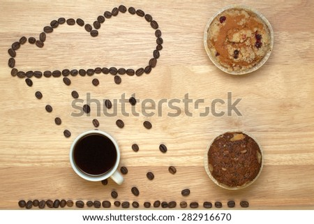 Top view coffee,muffins and applications from coffee beans - stock photo