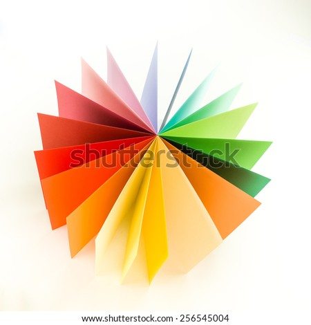 top view colorful origami paper arranged in circle fan shape on white background - stock photo