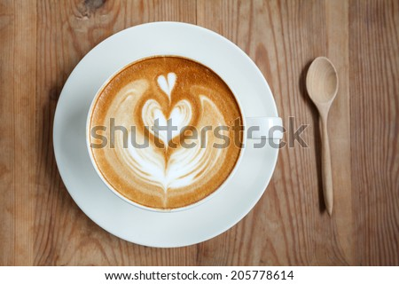 Top view cup of coffee latte with spoon  - stock photo