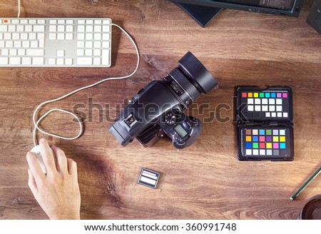 Top view Desktop shot of a modern Digital Medium Format Photo Camera with Mouse and Keyboard on stylish wooden desktop workplace / Background