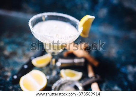 Top view details of margarita garnish, limes and glass - stock photo