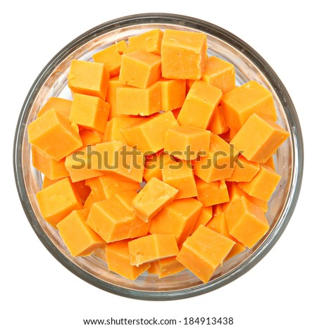 Top View Diced Cheddar Cheese Squares in Bowl Over White - stock photo