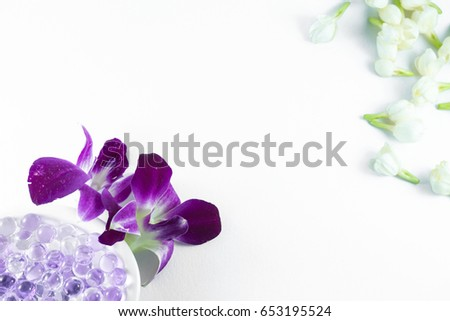 Top view flower of spa themed objects on white background.
