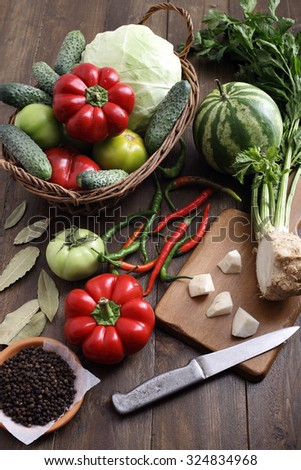 top view fresh assorted vegetables on rustic table background - stock photo
