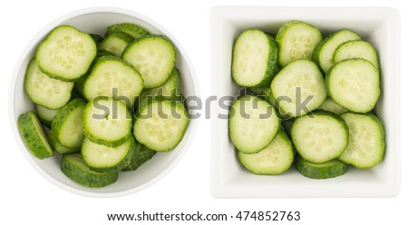 Top view Fresh slice cucumber in white bowl on white background.