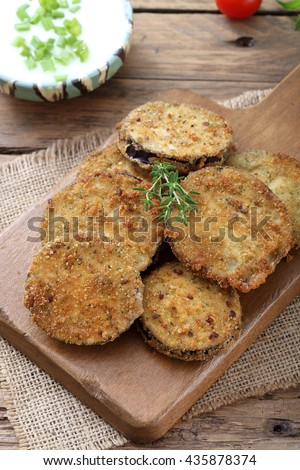 top view fried eggplant  on kitchen table background - stock photo