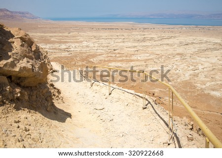 Top view from Masada fortress to the Judaean desert - stock photo
