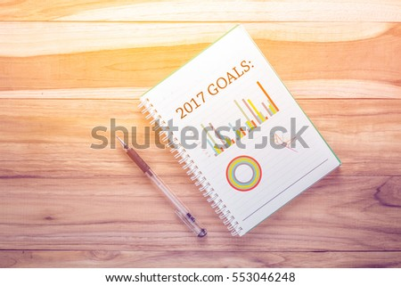 Top view 2017 Goals chart with notebook on wooden desk