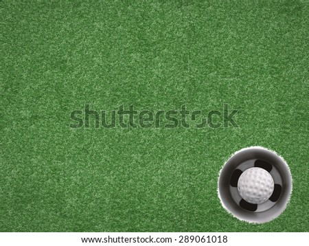 top view golf ball in golf cup on turf background  - stock photo