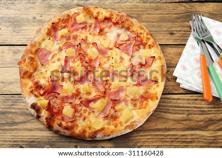top view hawaiian pizza rustic table background - stock photo