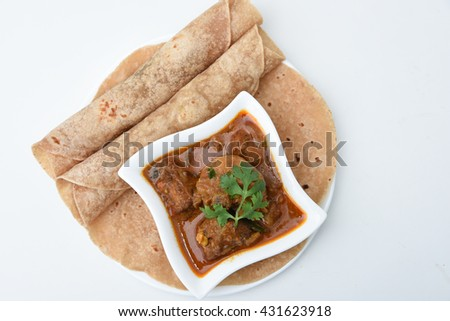 Top view homemade fresh chapati, chapathi, chapatti, roti or flatbread made from whole wheat flour / atta  and chicken tikka masala curry Mumbai North India. famous Indian basic food. Indian spices  - stock photo