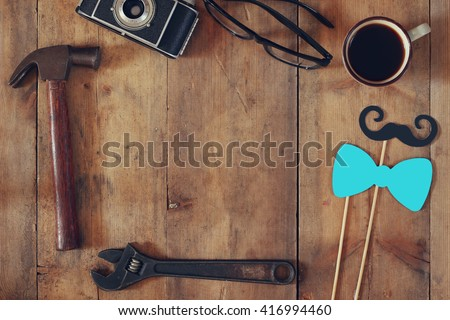 top view image of fathers day composition with vintage father's accessories on wooden table. vintage filtered  - stock photo