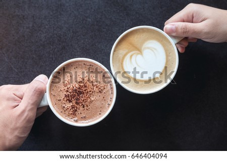 Top View Image Of Man And Woman S Hands Holding Coffee And Hot Chocolate Cups With Wooden