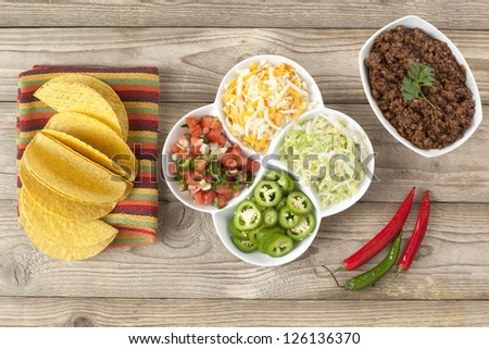 Top view image of mexican tacos ingredients on wooden board - stock photo