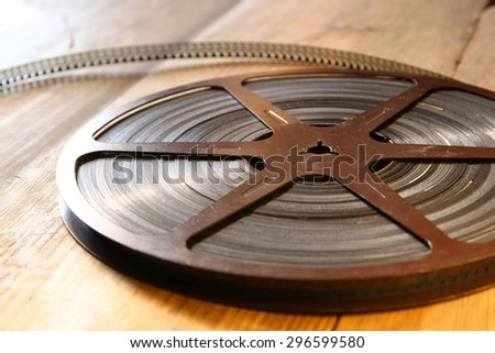 top view image of old 8 mm movie reel over wooden background