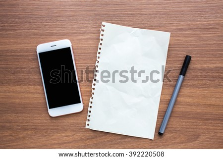 Top View Image of Paper Sheet, Smartphone and Pen on Wooden Background