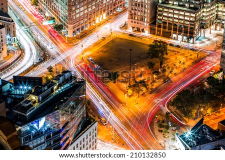 Top view in New York with traffic trails on Canal Street and Avenue of Americas - stock photo