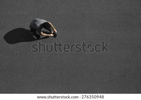 Top view jogging man runner tying running shoes before outdoor workout. Smiling mixed race Asian Caucasian male runner and fitness sport model before work out.  - stock photo