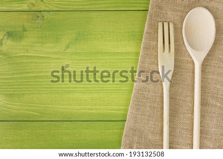 top view kitchen table wooden spoon fork  - stock photo